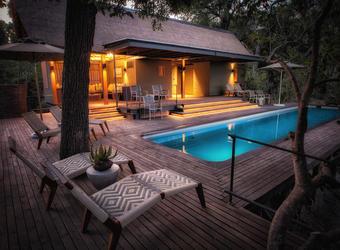 Chitabe camp, spacious modern bathroom, equisite indoor/outdoor shower, dual vanity sinks, canvas ceiling, stained hardwood floors, Okavango Delta