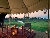 Duba Plains Camp, expansive en suite bathroom, soft comfortable robe, double vanity sink with pocelain, very wide mirror, shower with view into nature