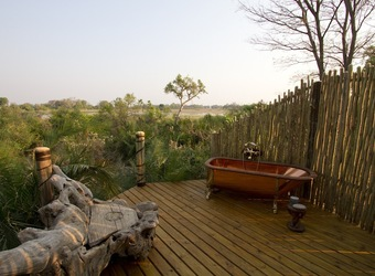 Jacana Camp, outdoor bathroom with soaking tub open to nature, secluded wooden deck with views of savanna, fenced in area, quiet solitude