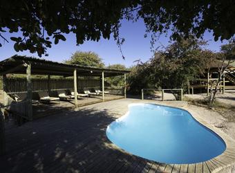 Khalahari Plains Camp, en suite bathroom, large shower with window for animal viewing, shiny hardwood floors, double fish bowl sinks, Africa, Botswana