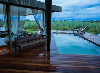 Selinda Camp, an exquisite en suite bathroom with a massive wash tub centered in the middle of the walk in bathroom with two separate rooms in Africa