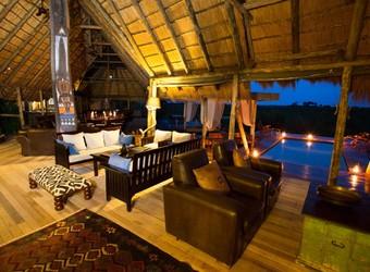 Selinda Camp, amazing outdoor dining circle set around a campfire, luxury dining, high end safari, African safari luxury, Botswana candlelit dinner