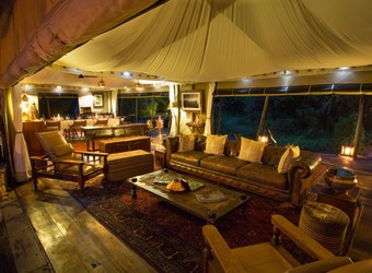 Zarafa Camp, circle of comfortable folding chairs perched around an inlaid fire overlooking the expanse of wetlands of the Okavango Delta, Botswana