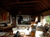 Borana Lodge, the indoor lounge area of the lodge complete with comfortable white couches and spacious accomodations for relaxing in Kenya, Africa
