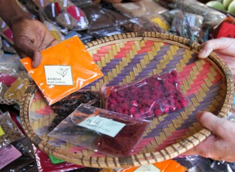 Spices and homemade souvenirs and baskets are exchanged at a local market in Zanzibar, Tanzania