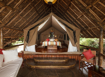 An expansive tented bedroom from a luxury safari camp in Amboseli, Kenya