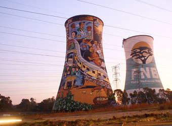 A couple of grain silos painted voer with beautiful murals and graffiti in vibrant colors, shapes, and designs in Johannesburg, South Africa