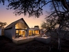Lion Sands Ivory Lodge modern glass fronted villa in the woods