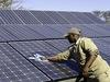 Khalahari Plains Camp, camp employee in hat washing off solar pannels, checkerboard solar pannels, Botswana safari, Africa