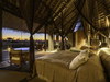 Jao Camp, massive luxury bedroom, personal seating area, large canopy for giant bed, high vaulted wooden celings, Africa, Botswana safari