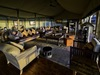 Tobu Tree Camp, huge indoor lounge area with a selection of seating options including luxury couches and chairs in Botswana, Africa luxury safari