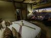 Khalahari Plains Camp, expansive luxury bedroom, beautiful vista of African sunset, beautiful bed decoration, reading desk, private deck, Botswana