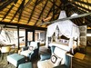 Kings Pool Camp, amazing luxury bedroom, burnished wood table, canopied bed, vaulted ceilings, exquisite furnishings, Botswana, Africa safari