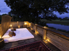 Savuti, private sleepout bed for sleeping under the stars on a protected raised wooden deck surrounded by inclusive railing in Botswana, Africa