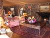 Lewa Wilderness Lodge, rustic interior lounge area of the safari lodge, intricate stonework accompanied by comfortable furniture in Kenya, Africa