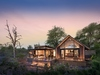 Lion Sands Ivory Lodge Jacana Suite exterior modern villa at dusk