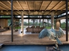 open air living room water feature glass walls industrial modern living