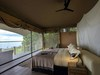 Duma Tau Camp, secluded private bedroom with spectacular view of Okavango Delta mere feet from bed, comfortable king bed with overhanging fan