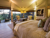 Abu camp,welcoming bedroom with exquisite luxury furniture, elegant decoration, comfortable single beds, Botswana safari camp elephant photo, Africa