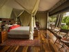 Zarafa Camp, humungous master bedroom set up on an expansive wood floored platform above an outdoor viewing deck area in Botswana, Africa safaris