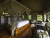 Seba Camp, large bedroom in tented safari camp with vaulted ceilings and beautiful polished checkered wooden flooring in Botswana, Africa safaris