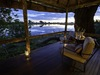 Savuti, excluded private resting and dining area with a view overlooking the surrounding wilderness and perfectly clear watering hole in Botswana