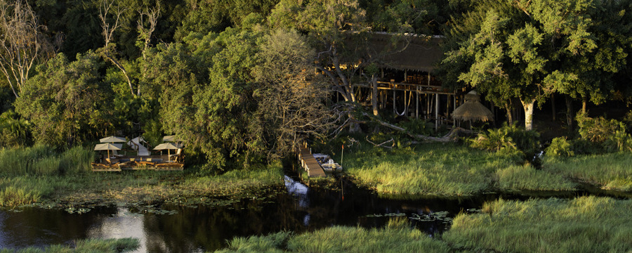 Elegantly situated safari camp on the lush western side of the Okavango Delta, dock next to the Delta with boat for wildlife viewing, lounge area