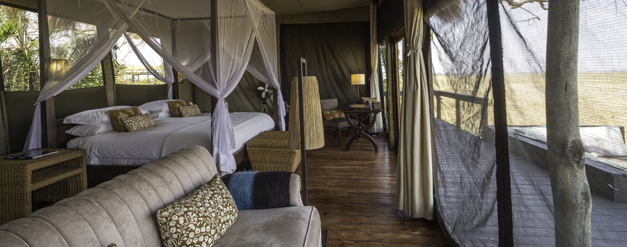 Shumba Camp Kafue National Park Zambia tented luxury room with four poster bed and mosquito netting