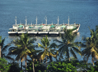 A row of several boats in the very important harbor of the vital city of Dar es Salaam, Tanzania